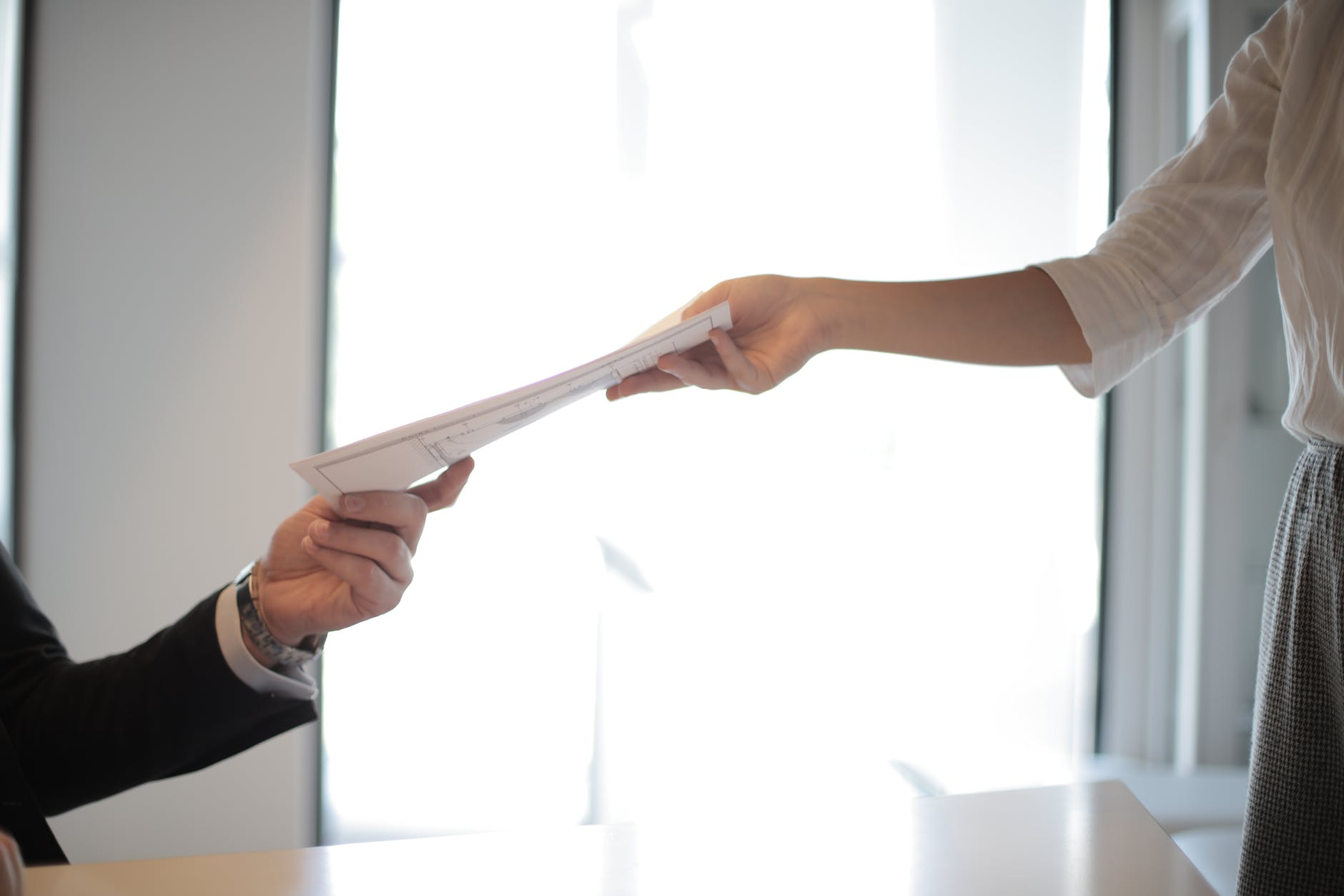 job applicant passing her documents resume how to find a job